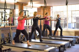 Learn how to use the reformers in our beginner pilates course